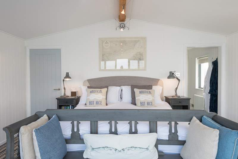 The second bedroom on the first floor is simply stunning, with its own private balcony.