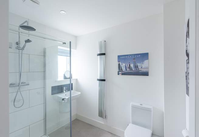 The downstairs shower-room is perfect for washing away the sand.