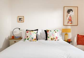 The double bedroom filled with warming tones (Bedroom 2).