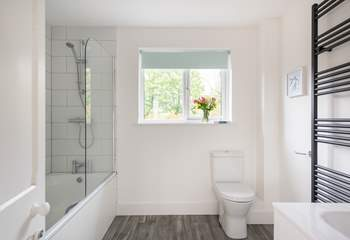 The family bathroom on the first floor has a lovely tub for two.