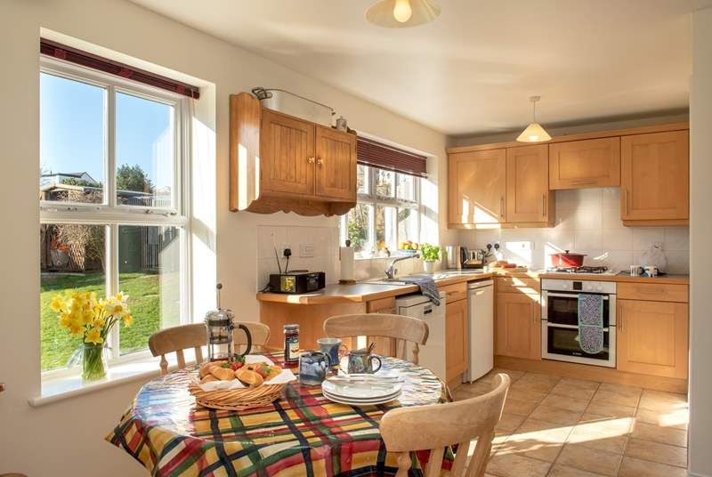 The sunny kitchen/breakfast-room overlooks the back garden.