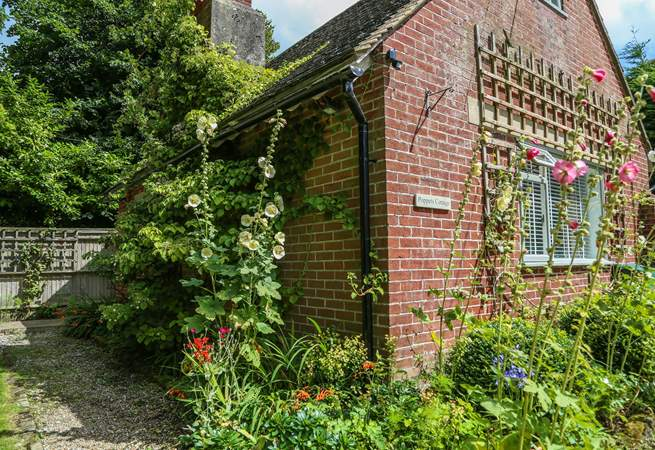 Flowers adorn Poppets Cottage.