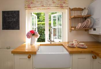 The kitchen has a gorgeous Belfast sink...