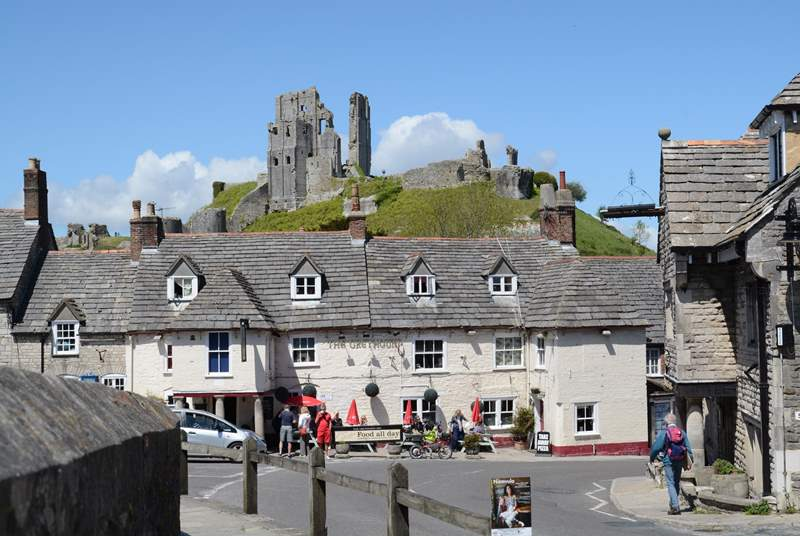 Corfe Castle dominates the village of Corfe on the Isle of Purbeck, gateway to the World Heritage Jurassic Coast.