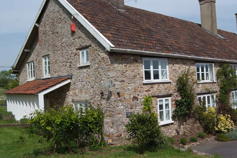 Whitehall Farm Cottage is half of an historic farmhouse in a wonderful setting overlooking the Otter Valley in East Devon.
