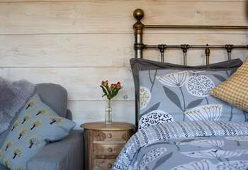 The cabin is decorated with a calming colour scheme of soft greys and whites, with a hint of mustard yellow.