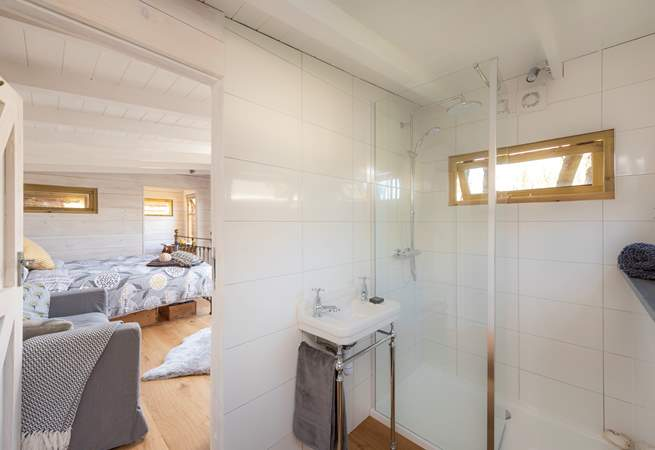 The stylish en suite shower-room is at the other end of the cabin, accessed via the living-room.