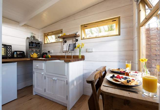 At the far end of the cabin is the compact but well-equipped kitchen, complete with an electric mini oven, fridge, kettle and toaster.