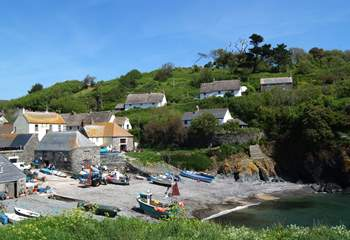 A view of the small beach at Cadgwith from 'The Todden' which divides the cove and is a popular spot with locals and visitors alike.