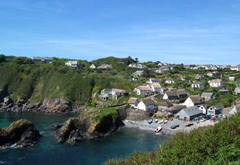 Looking down on the charming village of Cadgwith from the coast path along the cliffs.