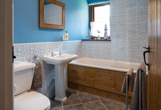 The ground floor bathroom is situated next to Bedroom 1 (up the steps).