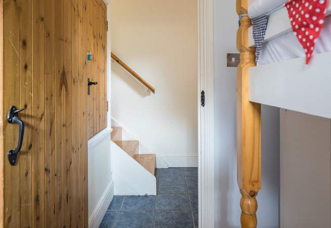 The steps leading down from the living-area into the utility-room which then leads into the bunk room.