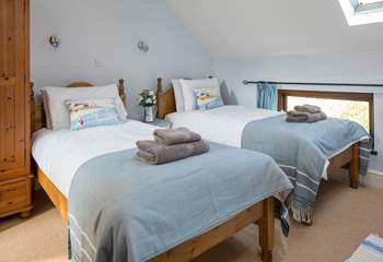 The delightful twin room is a great bedroom for both young and old, especially as it has a spacious en suite with bath and fitted shower.