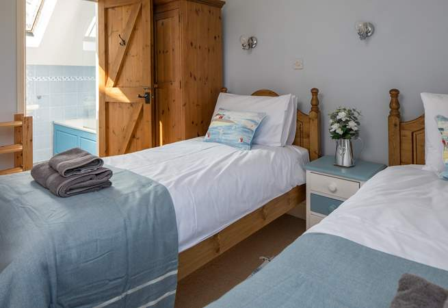 Bedroom 3 offers two single beds with an en suite.