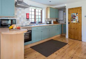 The large and well-equipped kitchen makes rustling up any meal a pleasure.