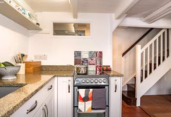 The open plan kitchen/diner leads up to the two bedrooms.