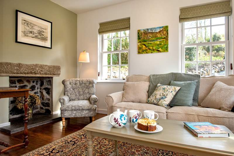 The main sitting-room has a big comfy sofa to chill out on.