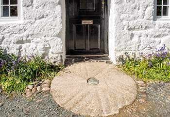 The original millstone makes for a fabulous doorstep.