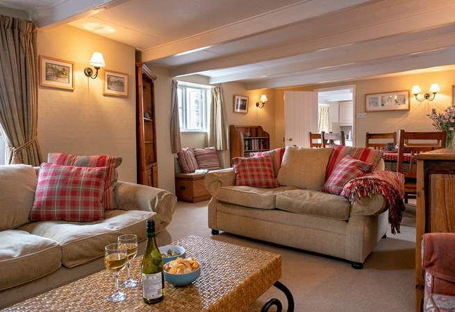 Enjoy relaxing on the sofas with a glass of wine.
