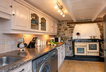 The kitchen will fulfill your every need.