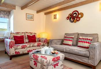 Cosy up in the sitting-room in front of the wood-burner.