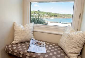 The sitting-room has a cute window seat, settle down with a good book.