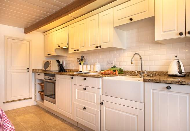 The kitchen is very charming.