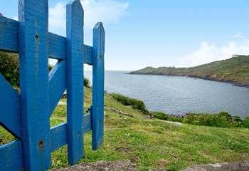 There is a gate that opens to the headland.