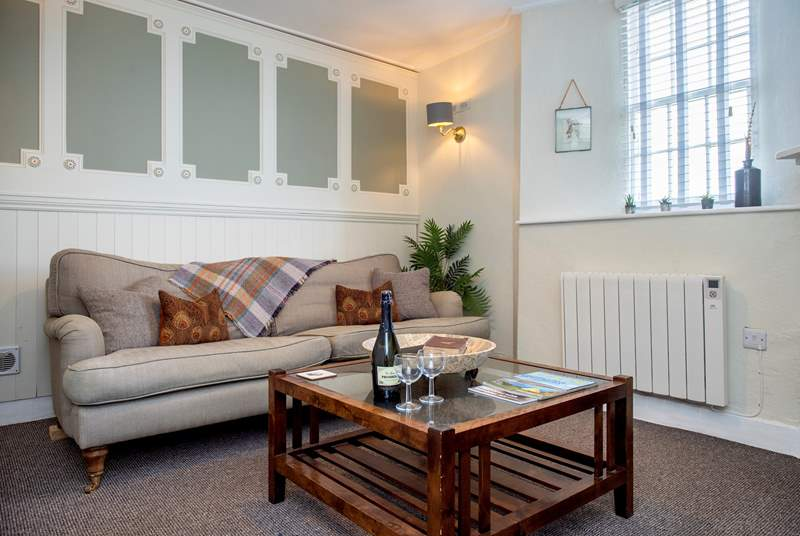The sitting-room is a lovely room in which to unwind and relax.