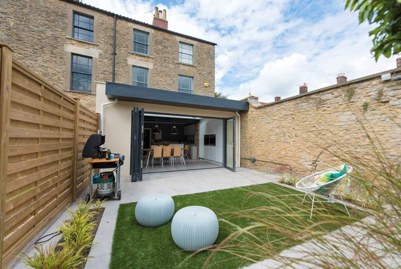 This stunning Georgian town house has a walled garden and floor to ceiling bi-fold doors that create a wonderful inside/outside space.