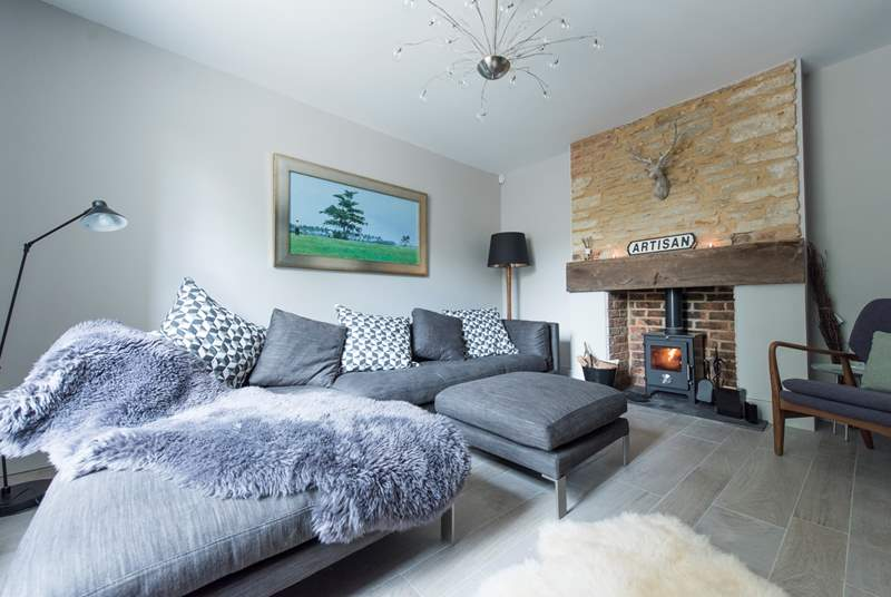 The sumptuous living-room with its wood-burning stove is another totally relaxing space to enjoy.