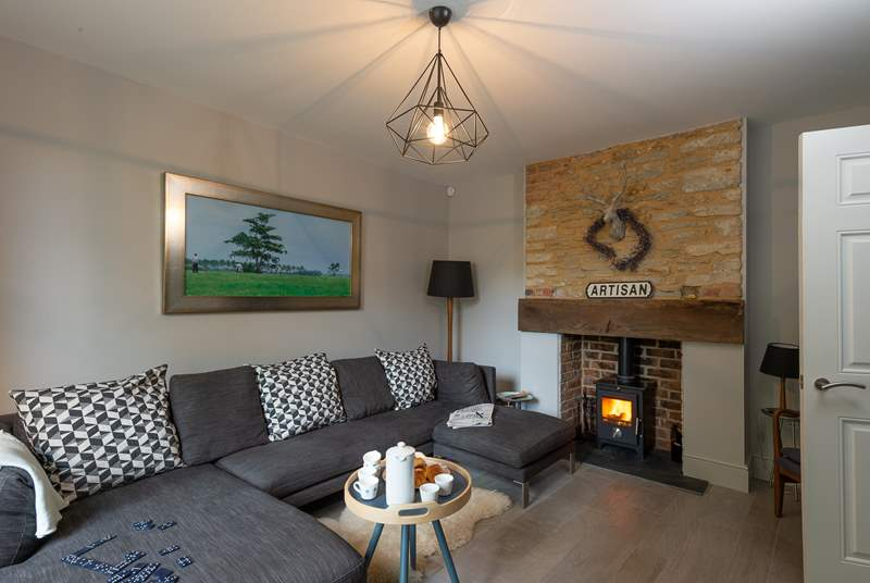 The welcoming living room is perfect for relaxing by the wood burning stove.