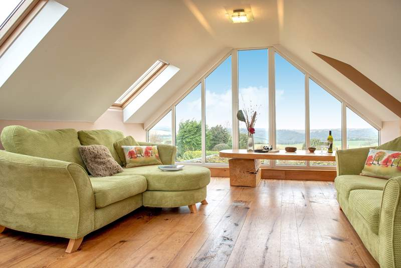 The sitting-room is on the first floor making the most of those wonderful views.