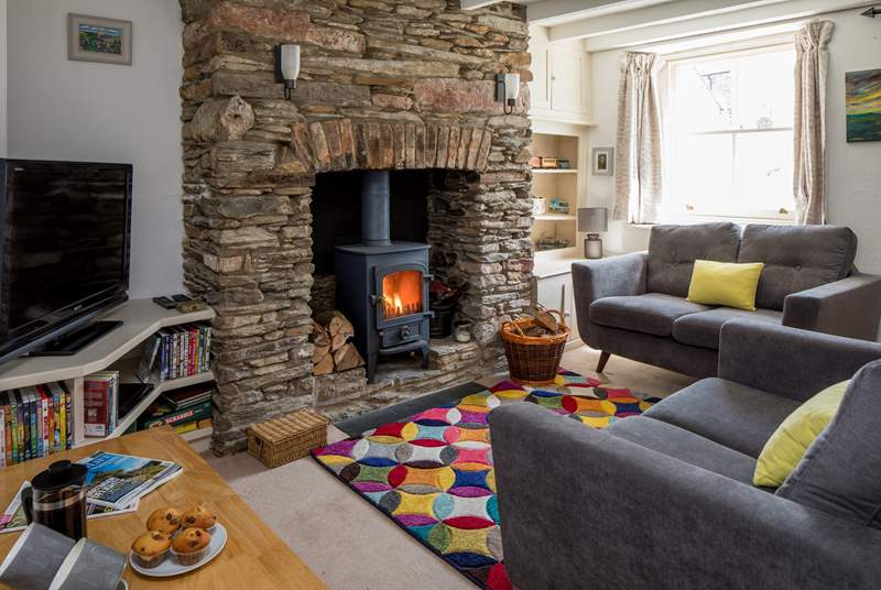 The glowing wood-burner really sets off this cosy sitting-room.