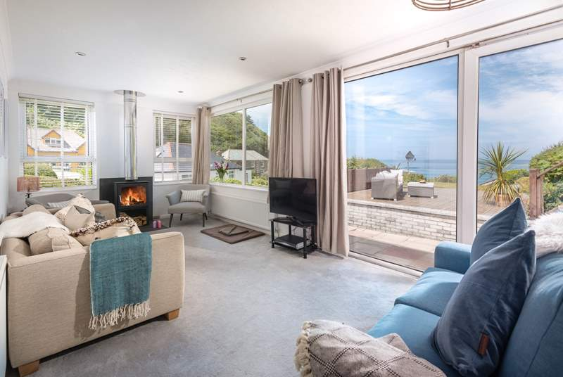 The sitting-room takes full advantage of the sea views.