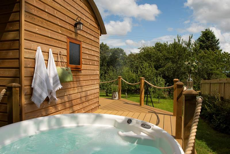 Tucked away in its own private orchard with a bubbling hot tub.