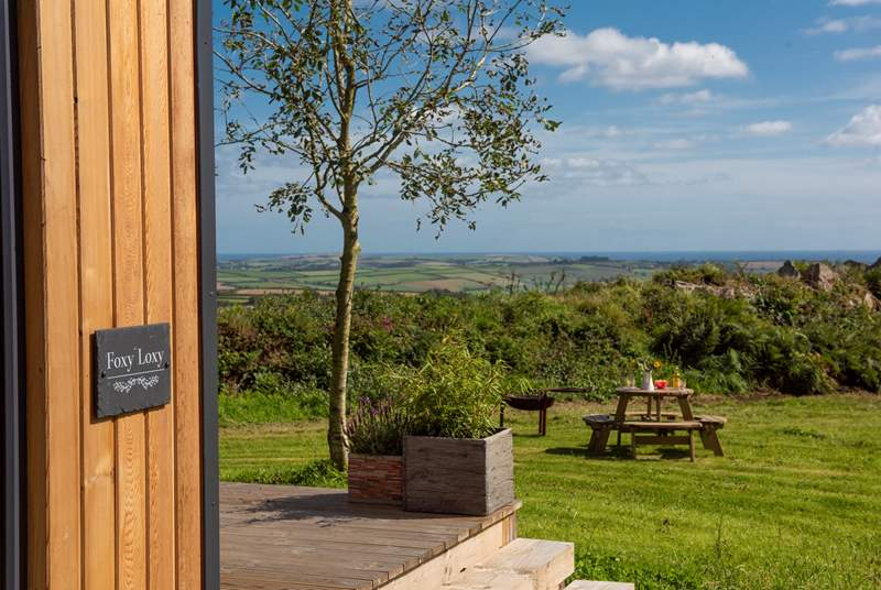 There are gorgeous far-reaching views over countryside to the sea in the distance.