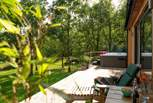The deck with loungers soaking up the sunshine and enjoying the fabulous views tucked away next to the woodland.