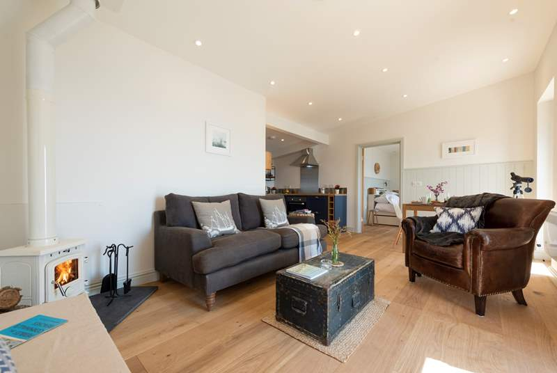 The open plan living-room is both spacious and stylish.