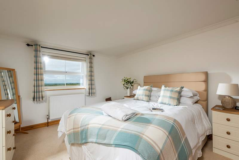 The spacious master bedroom with sea views and an en suite shower-room.