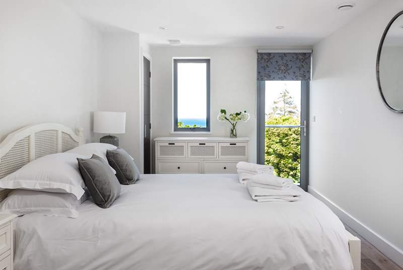 The master bedroom with sea views has a little door leading out onto the balcony.
