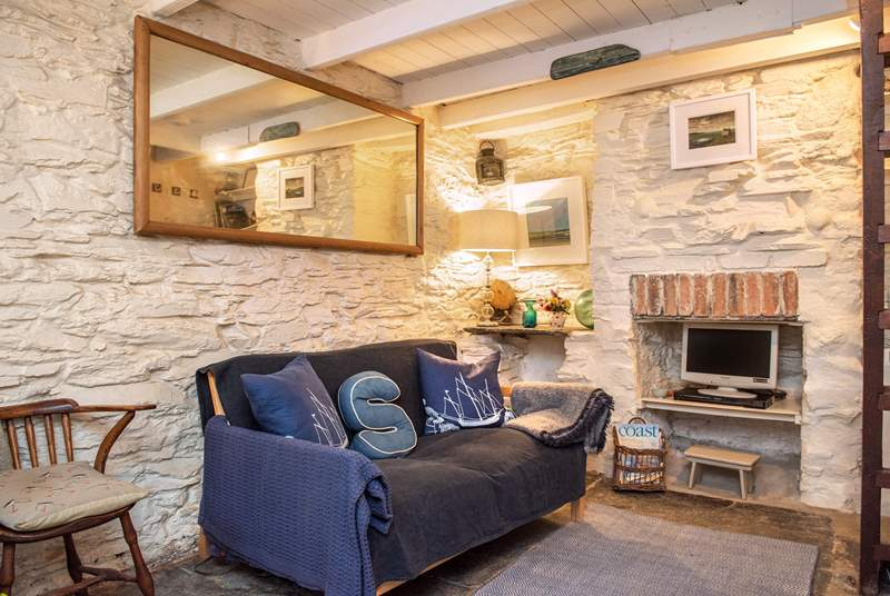 The open plan living-room is full of character.
