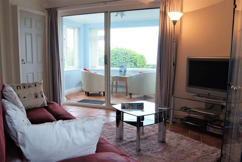 The sun-room has views to Praa Sands and the sea beyond.