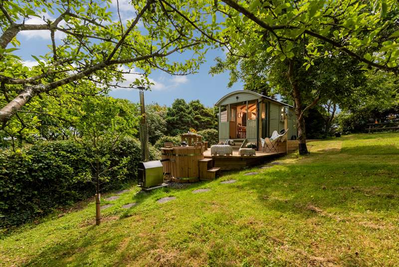 Nestled into a cider orchard within a four-acre woodland garden, this delightful and cosy rural retreat is perfect for a 'get back to nature' experience.