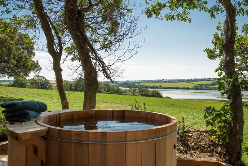 With absolutely stunning views over a green meadow to the Camel Estuary.