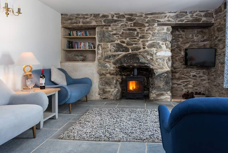 The sitting-room has a cosy wood-burner to snuggle up in front of, perfect for those chillier evenings.