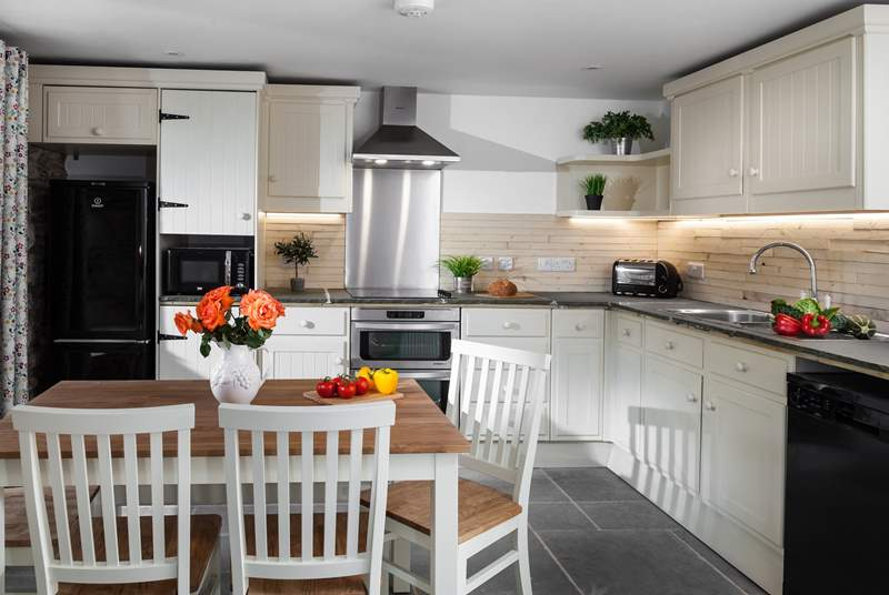 The open plan kitchen/diner hosts a hand-crafted kitchen.