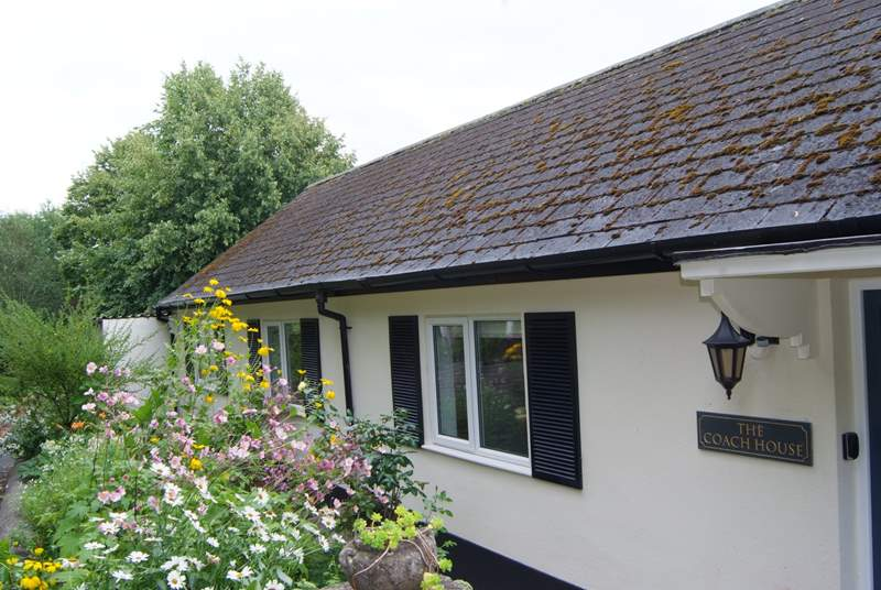 This single-storey cottage is exceptional high quality, with plenty of  private parking, a terrace and extensive gardens.