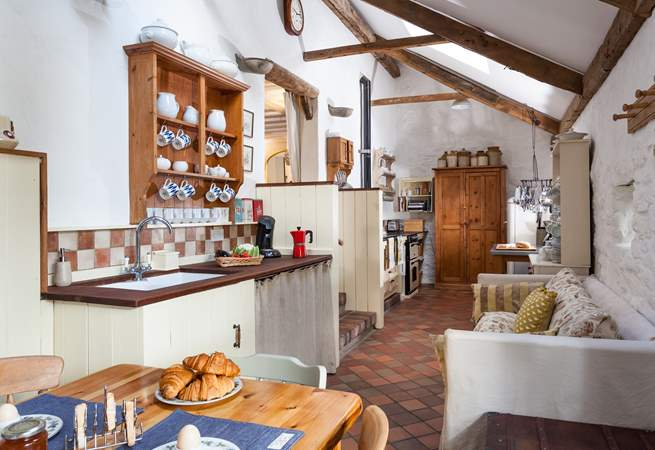 The cottage kitchen/diner is full of charm and character. Three reclaimed brick steps lead up to the sitting-room.