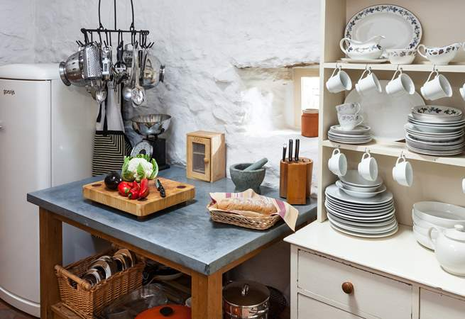 There are lots of little 'cottage' touches throughout, like this cute crockery set.